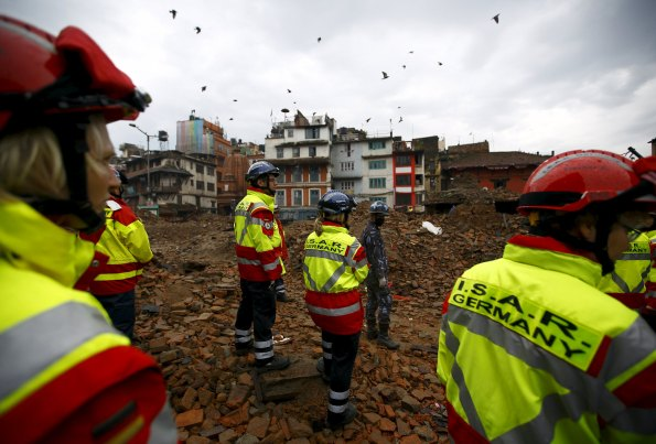 Members of German rescue team work near the collapsed temple in search of victims after the earthquake in Kathmandu