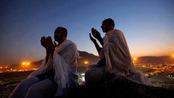 AP10ThingsToSee - Muslim pilgrims pray on a rocky hill called the Mountain of Mercy, near the holy city of Mecca, Saudi Arabia, Monday, Oct. 14, 2013. Joined by their faith and a desire to purify their souls, more than 2 million Muslims from nearly 200 countries gathered around a hill in Saudi Arabia on Monday marked by a small white pillar. It is here, in Mount Arafat on the Mountain of Mercy, known in Arabic as Jabal al-Rahma, that the Prophet Muhammad is believed to have delivered his last sermon to tens of thousands of followers, calling on Muslims to unite.(AP Photo/Amr Nabil, File)