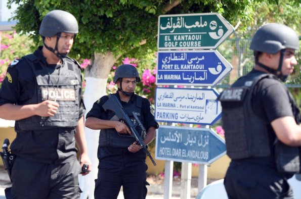 Tunisian police surround the area around the beachside hotel in the hunt for the gunman.