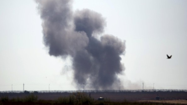 Smoke rises in Egypt's North Sinai along the border with southern Israel, July 1, 2015. Islamic State militants launched a wide-scale coordinated assault on several military checkpoints in Egypt's North Sinai on Wednesday in which 50 people were killed, security sources said, the largest attack yet in the insurgency-hit province. Egyptian army F-16 jets and Apache helicopters strafed the region that lies within the Sinai Peninsula, a strategic area located between Israel, the Gaza Strip and the Suez Canal. REUTERS/Amir Cohen       TPX IMAGES OF THE DAY