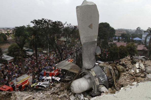 A propeller from an Indonesian military C-130 Hercules transport plane rests on the roof of a building after the plane crashed into a residential area in the North Sumatra city of Medan, Indonesia, June 30, 2015. REUTERS/Roni Bintang