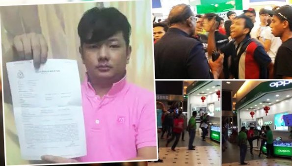 Mobile phone salesman See Ming Ho, 28, membuat report