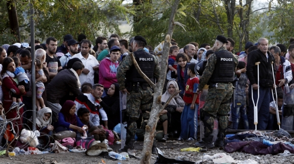 Macedonian police continued to block refugees from entering Macedonia from Greece for a second day on Saturday [AP]