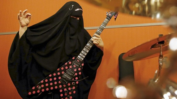 "Gisele Marie, a Muslim woman and professional heavy metal musician, plays her Gibson Flying V electric guitar during a rehearsal at a studio in Sao Paulo January 27, 2015. Based in Sao Paulo, Marie, 42, is the granddaughter of German Catholics, and converted to Islam several months after her father passed away in 2009. Marie, who wears the Burka, has been fronting her brothers' heavy metal band ""Spectrus"" since 2012. ""People do not expect to see a Muslim woman who uses a Burqa, practices the religion properly and is a professional guitarist who plays in a Heavy Metal band, so many people are shocked by it. But other people are curious and find it interesting, and others think that it is cool, but definitely, many people are shocked,"" said Marie. Picture taken January 27, 2015. REUTERS/Nacho Doce"
