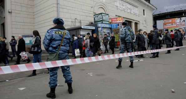 Police officers evacuate people from Park Kultury (Park of Culture) subway station in downtown Moscow on Monday, March 29, 2010. Two female suicide bombers blew themselves up on Moscow's subway system as it was jam-packed with rush-hour passengers Monday, killing at least 35 people and wounding more than 30, the city's mayor and other officials said.(AP Photo/Misha Japaridze)